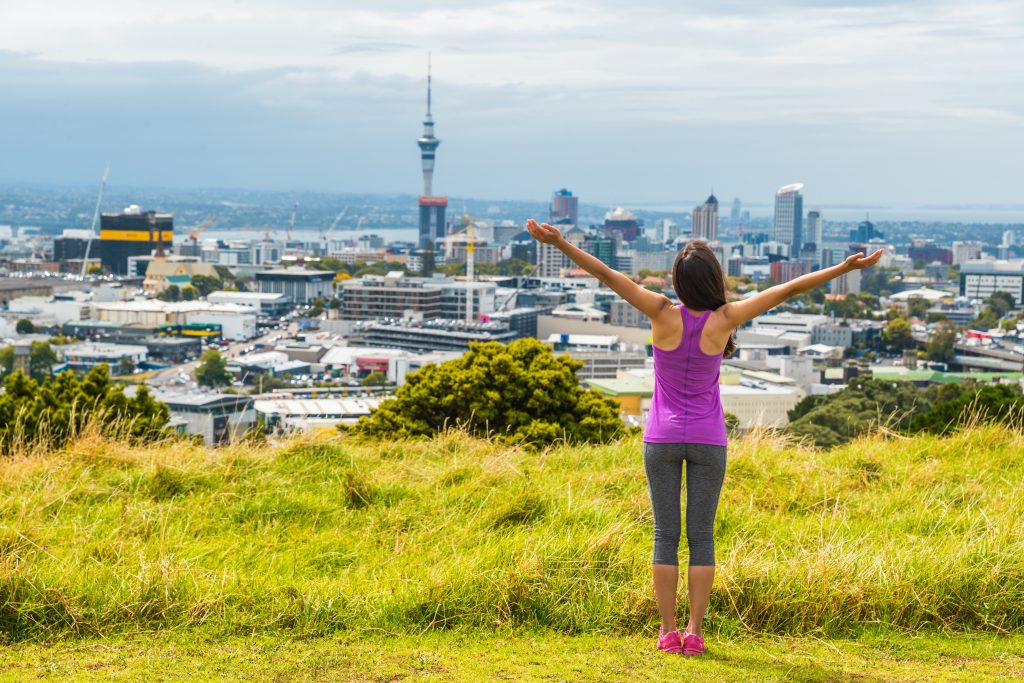 LAdy standing with view of Auckland city