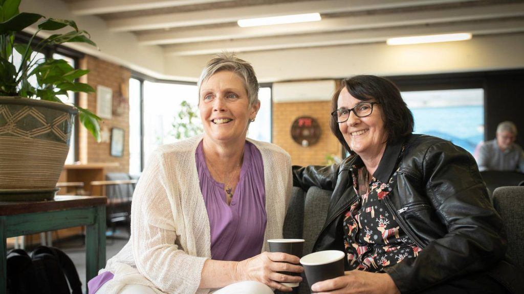Lesley and Julie sitting together having coffee